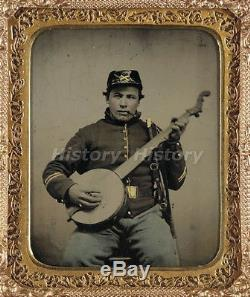 CIVIL WAR PHOTOGRAPH Unidentified soldier in Union cavalry uniform with banjo