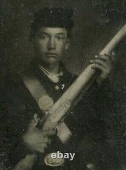Tintype of a CIVIL WAR Soldier with a GUN and Gilding